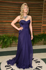 Katheryn Winnick glammed it up in a navy strapless gown with a long train during the Vanity Fair Oscar party.