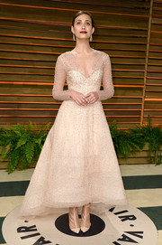 Emmy Rossum opted to pair her dress with nude lace booties, also by Monique Lhuillier, instead of traditional heels.