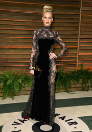 Poppy Delevingne was sexy-goth in a high-neck black lace-panel gown by Dolce & Gabbana during the Vanity Fair Oscar party.