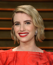 Emma Roberts swiped on some rich red lipstick for a bit of Old Hollywood glamour.