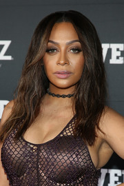 La La Anthony attended the 'Power' season 4 premiere wearing her hair in a center-parted style with barely-there waves.