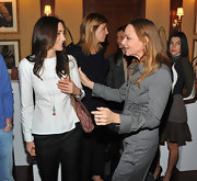 Nancy Shevell looked modest in her long-sleeve white blouse at the Stella McCartney autumn 2013 presentation.