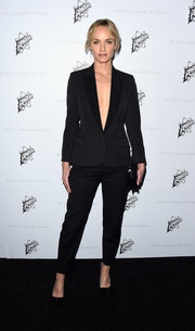 Amber Valletta was sleek in a plunging black suit that she added minimal style to with a clutch and pumps for an effortless look.