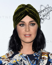Katy Perry topped off her outfit with a green velvet turban by Fount.