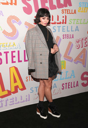 Vanessa Hudgens attended the Stella McCartney Autumn 2018 collection launch sporting an oversized gray jacket from the brand.