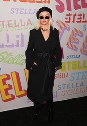 Christina Aguilera arrived for the Stella McCartney Autumn 2018 collection launch all bundled up in a black wool coat with a satin bow.
