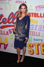 Rebecca Romijn made a sophisticated choice with this navy Stella McCartney dress with gold beading and split sleeves for the brand's Autumn 2018 collection launch.