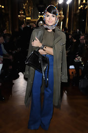 Miroslava Duma looked like she walked out of the seventies with these high-waisted, flare jeans and funky headscarf.