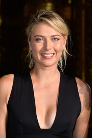 Maria Sharapova styled her tresses into a casual updo for the Stella McCartney fashion show.