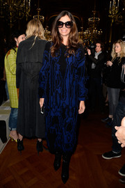 Christina Pitanguy bundled up in a distressed sweater dress for the Stella McCartney fashion show.
