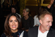 (L-R) Salma Hayek and Francois-Henri Pinault  attend the Stella McCartney show as part of the Paris Fashion Week Womenswear Spring/Summer 2015 on September 29, 2014 in Paris, France.