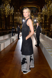 Maria Sharapova chose a plunging black-and-white dress with a sheer, horse-appliqued hem for the Stella McCartney fashion show.