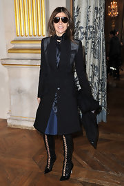Carine Roitfeld bundled up in style with a multitextured black coat during the Stella McCartney fashion show.