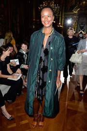 Shala Monroque looked regal in a teal evening coat layered over a floral dress during the Stella McCartney fashion show.