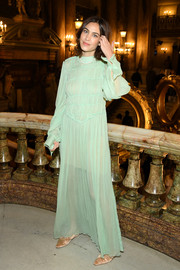 Alexa Chung attended the Stella McCartney Fall 2019 show wearing a mint-green maxi dress from the label.