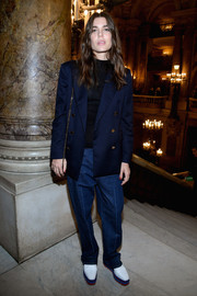 For her footwear, Charlotte Casiraghi chose a pair of white platform brogues.