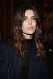 Charlotte Casiraghi wore her hair in hippie-chic waves at the Stella McCartney fashion show.