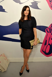 A huge fan of Stella McCartney, Liv showed her support for the designer at the Gap Kids event. She attended the soiree in a navy dress and a polka dot pretty gold clutch.