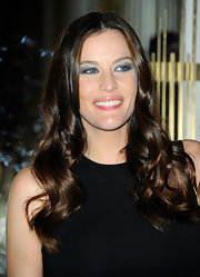 Liv Tyler wore shimmery shades of blue eyeshadow at the opening of the Stella McCartney store in Soho.