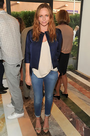Stella wore a navy cropped jacket that complemented her vibrant red hair color and dressed up her cuffed jeans.
