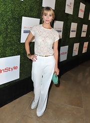 Meredith Monroe chose a monochromatic look when she paired this white lace top with a pair of crisp white trousers.