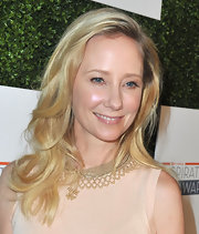 Anne Heche's blonde waves tumbled effortlessly on her shoulders!