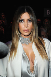Kim Kardashian totally glammed up her look with a thick diamond choker.