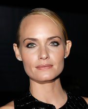 Amber Valletta opted for nude lipstick at Steven Klein's video installation preview. To duplicate her lip look, we recommend a soft golden-rose shade like Korres Mango Butter Lipstick SPF 10 in Naked Rose 22.