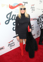 Suzanne Somers went for bold styling with a pair of fire engine-red boots.