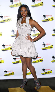 Condola Rashad wore a gathered silver cocktail dress to the 'Stick Fly' opening night.