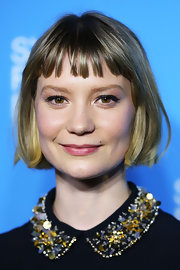 Mia Wasikowska exuded a youthful vibe at the 'Stoker' premiere with her short 'do and baby bangs.