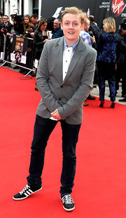 Thomas Turgoose chose a classic gray blazer for his look at the premiere of 'The Stone Roses.'