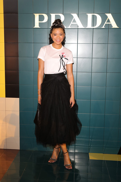 Storm Reid Evening Sandals [clothing,shoulder,fashion,dress,waist,snapshot,cocktail dress,joint,fashion model,design,womenswear fashion show - arrivals,storm reid,prada spring,front row,italy,milan,womenswear fashion show]