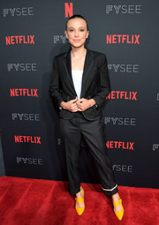 Millie Bobby Brown opted for a black Thom Browne suit when she attended the 'Stranger Things' Netflix FYSEE event.