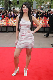 "Tulisa Contostavlos showed off her one-shouldered hip-hugging dress while attending the premiere of ""StreetDance 3D"""