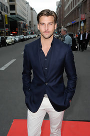 Johannes Huebl looked sleek and dapper in this navy blue blazer paired over a shirt of the same color.
