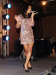 Dondria is a sparkling beauty in a dazzling textured cocktail dress while performing in Atlanta, Georgia.