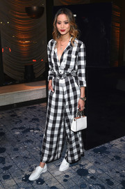 Jamie Chung rounded out her look with a white leather purse by Kate Spade.
