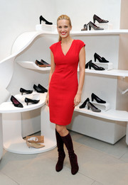 Petra Nemcova donned a red V-neck sheath with cap sleeves for the holiday gift-giving season kickoff.