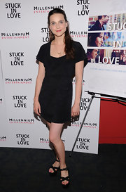 Maya sported a black dress that featured ruched details.