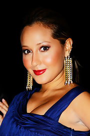 Adrienne Bailon rocked golden earrings complete with decadent gemstones.