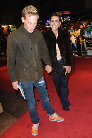 Laurence Fox looked subdued in his olive military jacket, but the orange sneaks were a zany surprise.
