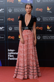 Alicia Vikander made a sexy-chic statement in a Louis Vuitton gown with a plunging neckline and a full, scallop-print skirt at the San Sebastian Film Festival premiere of 'Submergence.'