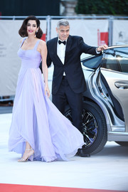Amal Clooney arrived for the Venice Film Festival premiere of 'Suburbicon' wearing strappy silver Aquazzura shoes and a floaty lavender gown.