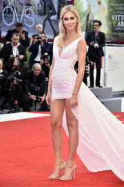 Chiara Ferragni put on a leggy display in a pale pink high-low dress by Philosophy di Lorenzo Serafini at the Venice Film Festival premiere of 'Suburbicon.'