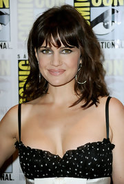 Actress Carla Gugino walked the 'Sucker Punch' red carpet at Comic-Con 2010 wearing large sterling silver  and diamond teardrop earrings.