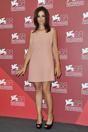 Alessia Barela rocked a blush shift dress at the Venice Film Festival.