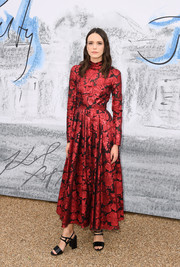 Stacy Martin kept it classy in a tea-length red brocade dress by Erdem at the 2019 Serpentine Gallery Summer Party.