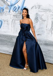 Maya Jama styled her dress with silver ankle-strap sandals.
