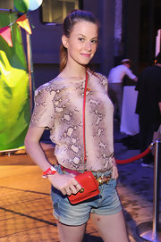Elettra Wiedemann accessorized with a tiny orange shoulder bag when she attended the Summer Party on the High Line.